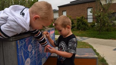 William Bray and Taj Swan play at the sensory play space at Lindrum Reserve in Belrose.