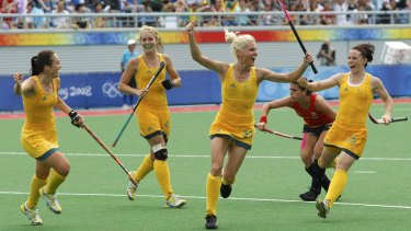 Hope Munro, far left, celebrates a goal with her Hockeyroos teammates in 2008.
