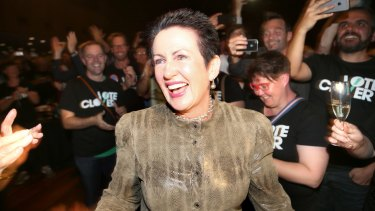 Supporters of Sydney lord mayor Clover Moore cheer her entrance on Saturday.