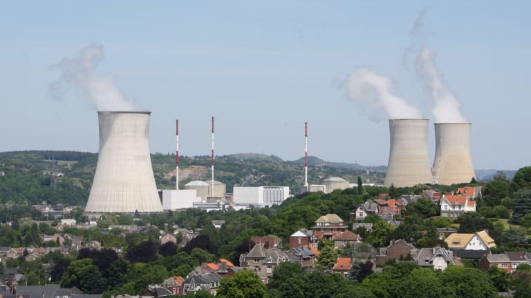 A guard who worked at a Belgian nuclear plant has been  murdered and his pass stolen. Pictured is Tihange nuclear power station in Huy.