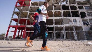 Nader al-Masri on a training run in the Gaza Strip town of Beit Hanoun.