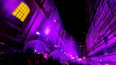 Melburnians enjoy the Purple Rain installation.