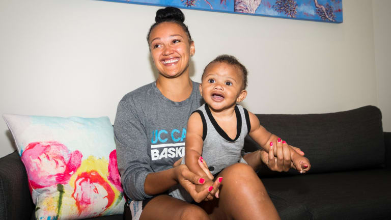 Capitals import Mistie Bass and her son Braven Boyd donated baby clothes and toys to Karinya House before returning home to the United States.