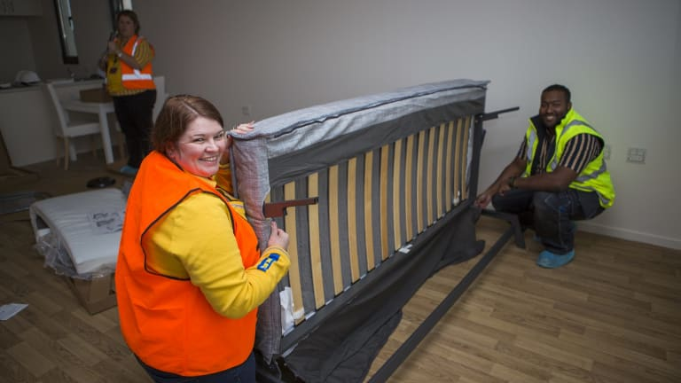 Ikea's customer support manager Leanne Wilding and recovery manager Saif Islam prepare furniture for the Common Ground public housing facility.