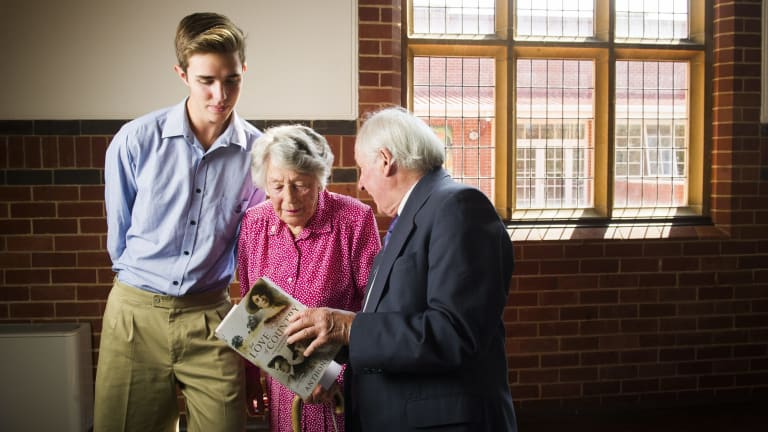 Canberra Grammar Eddison House Year 11 student Thomas Hart, With Pamela Yonge (sister of Pete, Jack, and Tom Eddison) with author of 'For love of country', Anthony Hill.