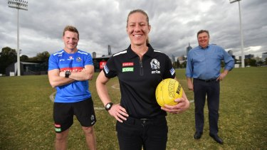 Collingwood coach Nathan Buckley, Collingwood women's football operations manager Meg Hutchins and Neil Balme.