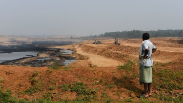 A Gonds tribesman looks over central India's Parsa East and Kante Basan coal mine. Operated by Adani, the mine has had a severe impact on the local environment.