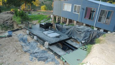 A trapdoor led to three buried shipping containers where a large hydroponic cannabis set up was allegedly discovered.