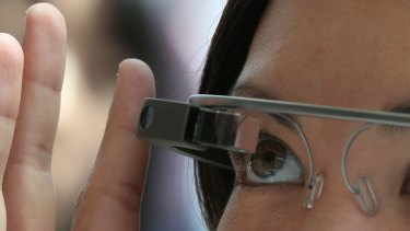 Through the looking glass: An attendee tries Google Glass during a Google developer conference earlier this year.