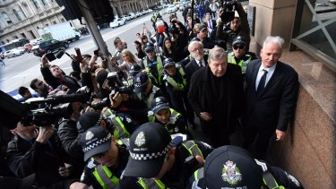 The Cardinal arrives at Melbourne Magistrates Court with his lawyers Paul Galbally (right) and Robert Richter, QC.