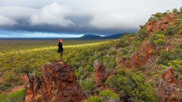 Jenita Enevoldsen on top of 'J5' viewpoint of the Helena Aurora Range.