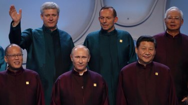 Prime Minister Tony Abbott looks down at Russian President Vladimir Putin during the APEC leader's photo with Canadian Prime Minister Stephen Harper (top left), Philippines President Benigno Aquino (bottom left), Malaysia Prime Minister Najib Razak (top right) and China President Xi Jinping (bottom right).