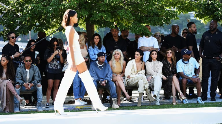 Tyga, Kylie and Kendall Jenner, Kim Kardashian, Carine Roitfeld and Pharrell Williams front row at Yeezy last week.