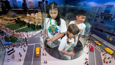 Caitlin, 11, Chloe, 8 and Owen, 10 enjoy a lego view of Melbourne at the opening of the Legoland Discovery Centre.