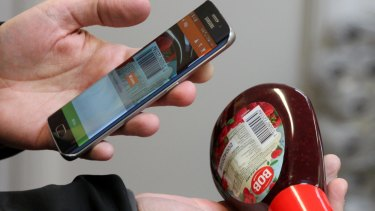 Swedish IT entrepreneur Robert Ilijason shows how to use a phone to scan a purchase at his unmanned store.