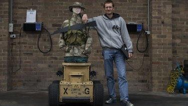 Marathon Targets chief executive Alex Brooks with robot XG.