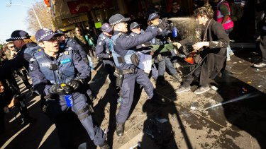Police deploy capsicum against  No Room For Racism supporters on July 18.