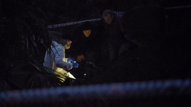 By nightfall, forensic officers in white suits were huddled over the bones with torchlights.