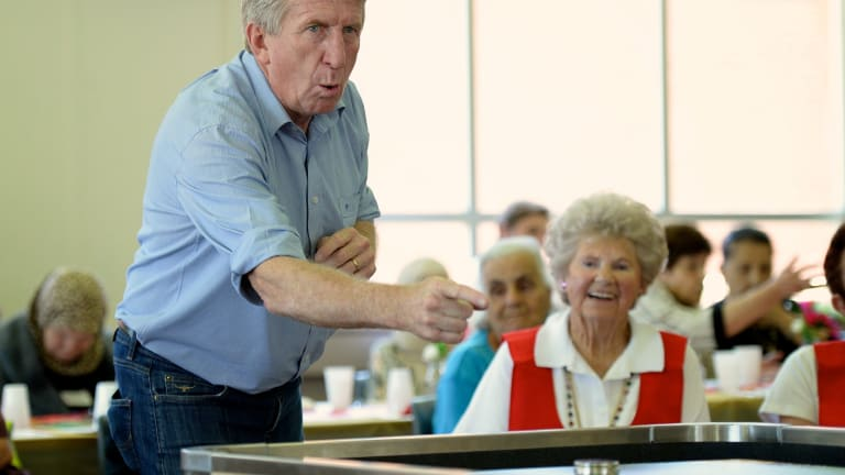 Passion: Steve Mortimer shows off his shuffleboard skills.