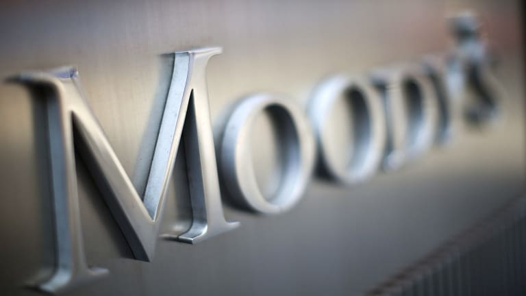 Moody's says banks' profit margins are being squeezed by record-low interest rates.