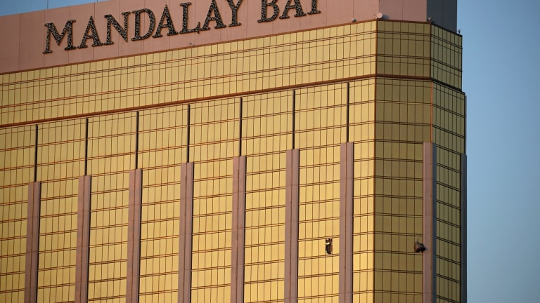 Drapes billow out of broken windows at the Mandalay Bay Resort and Casino. A gunman was found dead inside a hotel room.