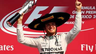 Nico Rosberg celebrates on the podium.