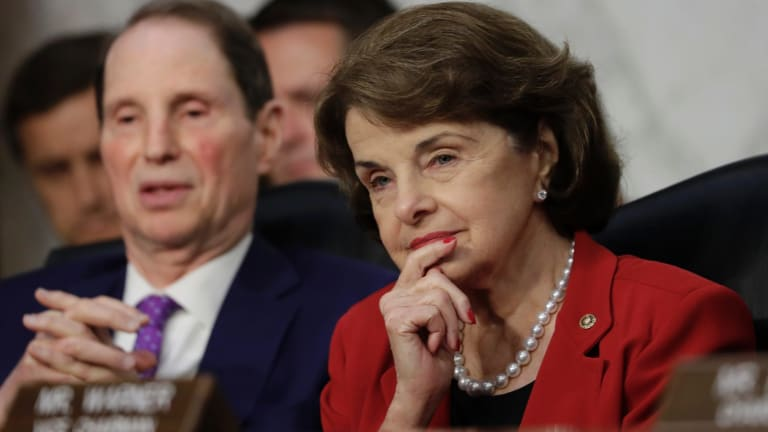 "Senator Dianne Feinstein (right) questioned Mr Trump over a deal for ""dreamers""."