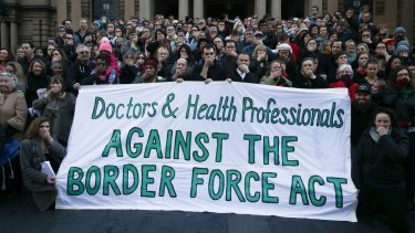 Doctors and health professionals at a Sydney protest last year. They stood with their hands over their mouths indicating they are being silenced by the new laws.