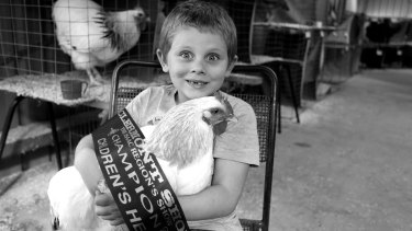 Paula Heelan's photograph of Rhys Reeves and his Coronation Sussex hen and first prize ribbon is the winner of the June Clique Challenge.