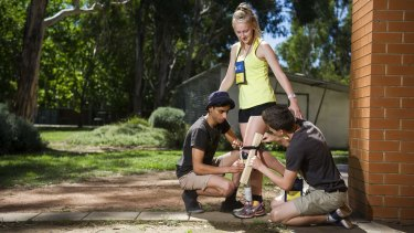 Keshav Kotecha, from Sydney, Abbey Godwin-Smith, from Hostrom, and Matt Dutton, from Adelaide, taking part in a prosthetic leg building exercise at the ANU College of Engineering.