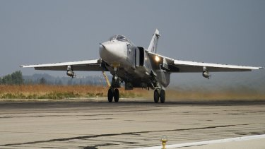 A Russian Su-24 takes off on a combat mission at Hemeimeem airbase in Syria in October last year.