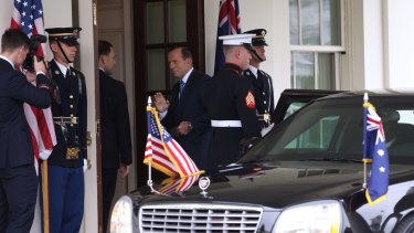 Prime Minister Tony Abbott arrives at the White House to meet the President of the United States, Barack Obama, in the Oval Office last year.