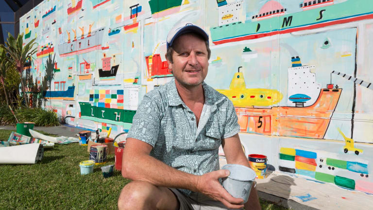 Brisbane artist Adam Lester with one of the large-scale murals he has completed to brighten up the walls of Lady Cilento Children's Hospital.