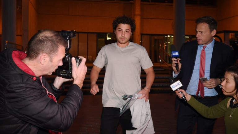 Daniel Ibrahim, also known as Daniel Taylor, the son of Kings Cross nightclub owner John Ibrahim, leaves the Sydney Police Centre after posting bail.