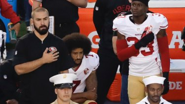 San Francisco 49ers quarterback Colin Kaepernick, middle, was the first player to kneel during the national anthem in September 2016.