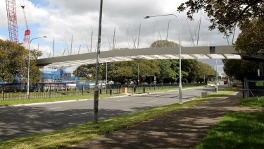 "Nearing completion: the Albert ""Tibby"" Cotter Bridge across Anzac Parade."