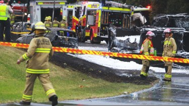 Firefighters at the scene of the Mona Vale crash that left two people dead.