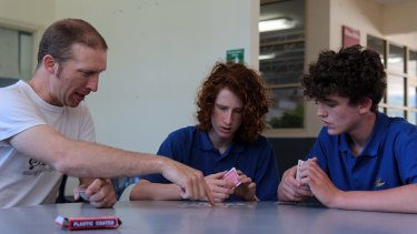 Upwey High students Aviv Dolan, centre, and Rory-Clay Edwards have improved their memories and academic performance with mnemonics techniques taught to them by teacher Dan Mayes.
