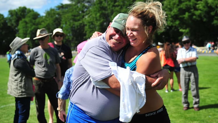 Sophie Broadhead and coach Dennis Goodwin celebrate her win in the women's Queanbeyan Gift.