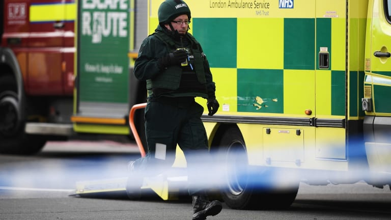 A paramedic in body armour runs down Westminster Bridge on Wednesday.