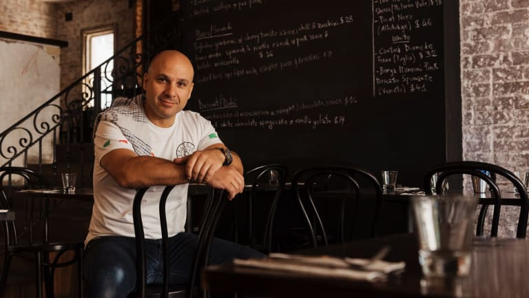 Robert Galati, at his Italian restaurant Fratelli & Co in Concord, Sydney, says he has lost 16 per cent off his bottom line to MenuLog.