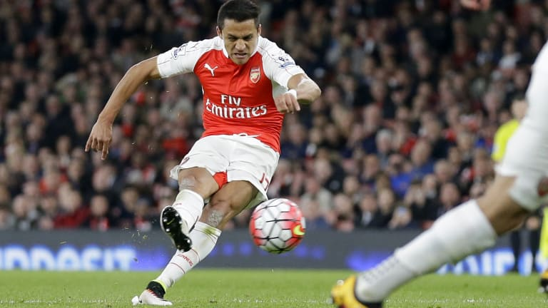 Arsenal's Alexis Sanchez scores his side's second goal from a free kick.