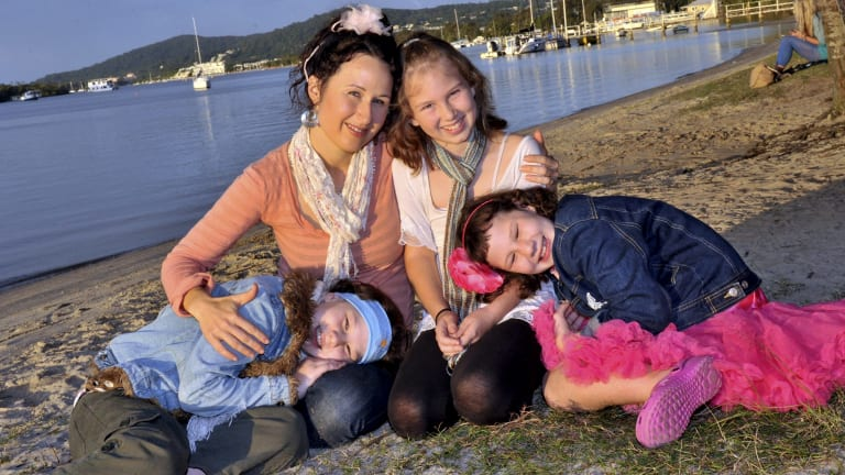 Matt Golinski's family -  wife Rachel Golinski with twin daughters Sage and Willow and sister Starlia -who perished in the house fire.