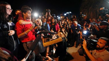 Tanzil Philip, 16, left, makes a passionate speech to supporters in Florida.