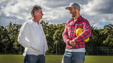 Old fortress: Sydney Swans co-captain Jarrad McVeigh, who is set to play his 250th match against Geelong Cats at ANZ Stadium on Saturday night, returned to his junior club, the Pennant Hills Demons, speaking to his under 11,12 and 14's coach, Peter Jack.