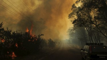 Parched properties: The risk of bushfires, like this near Lithgow last October, is elevated in a heatwave.