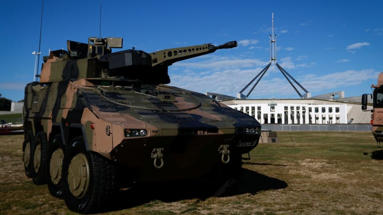 A combat reconnaissance vehicle outside Parliament last month. This model was built by Rheinmetall, which is a contender to build the new vehicles.
