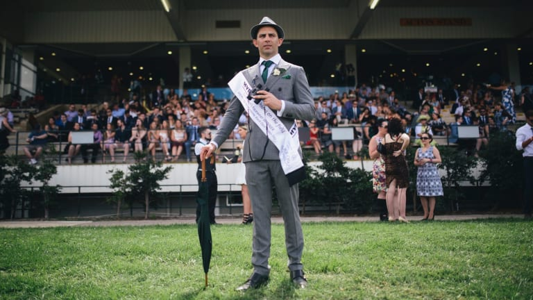 A classic grey suit with white shirt and green accessories made Hamish Lardi of Braddon the winner of Men's Fashions on the Field.