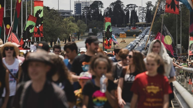 The protest marches through Canberra.