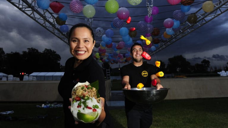 Stall holders Leilani Fox, of Kusina, and Carlos Ramirez, of Mr Papa, prepare for the Night Noodle Markets.